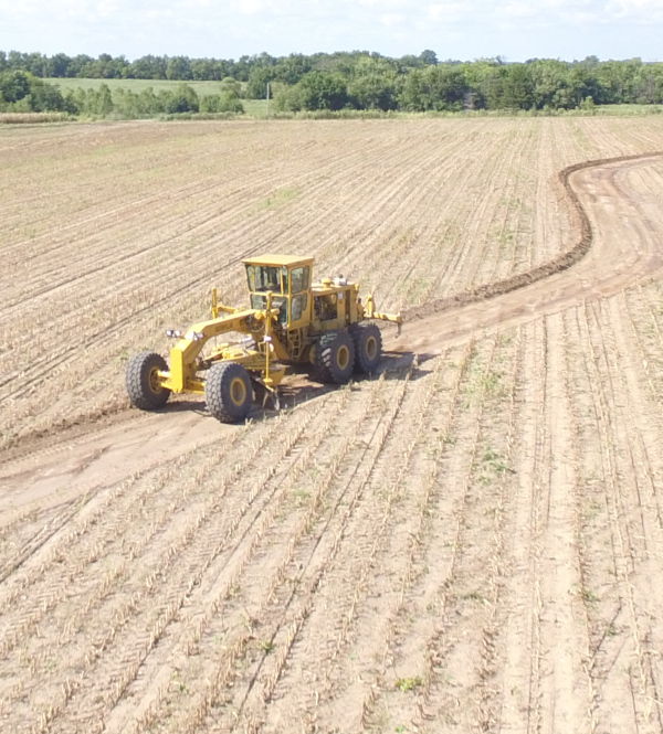 A Grader Building Farm Terraces using Crop Quest Farm Drainage Solutions